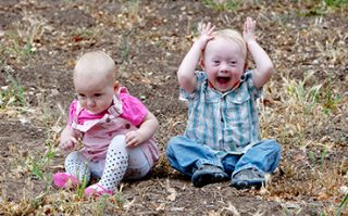 Two siblings play together, one has down syndrome.
