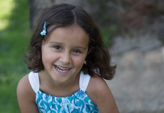 Portrait of young girl from TCRC's generic resources brochure.