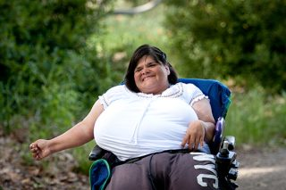 Portrait in the park of woman in wheel chair.