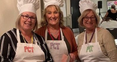 three women in apron and chef hats